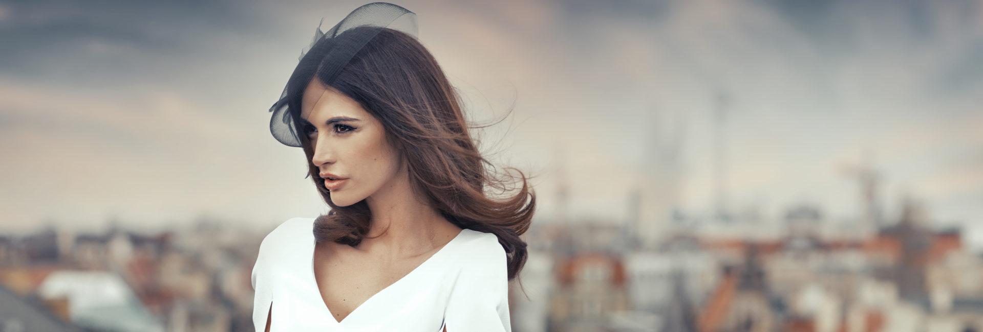 beautiful urban woman in white dress